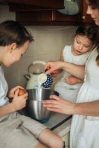 Mother and children make breakfast.